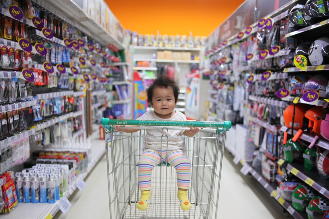 A little boy standing in front of a store